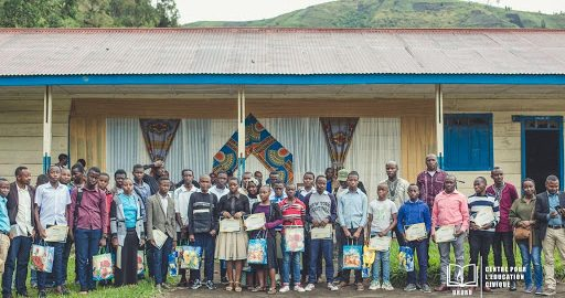 A group of young people holding certificates